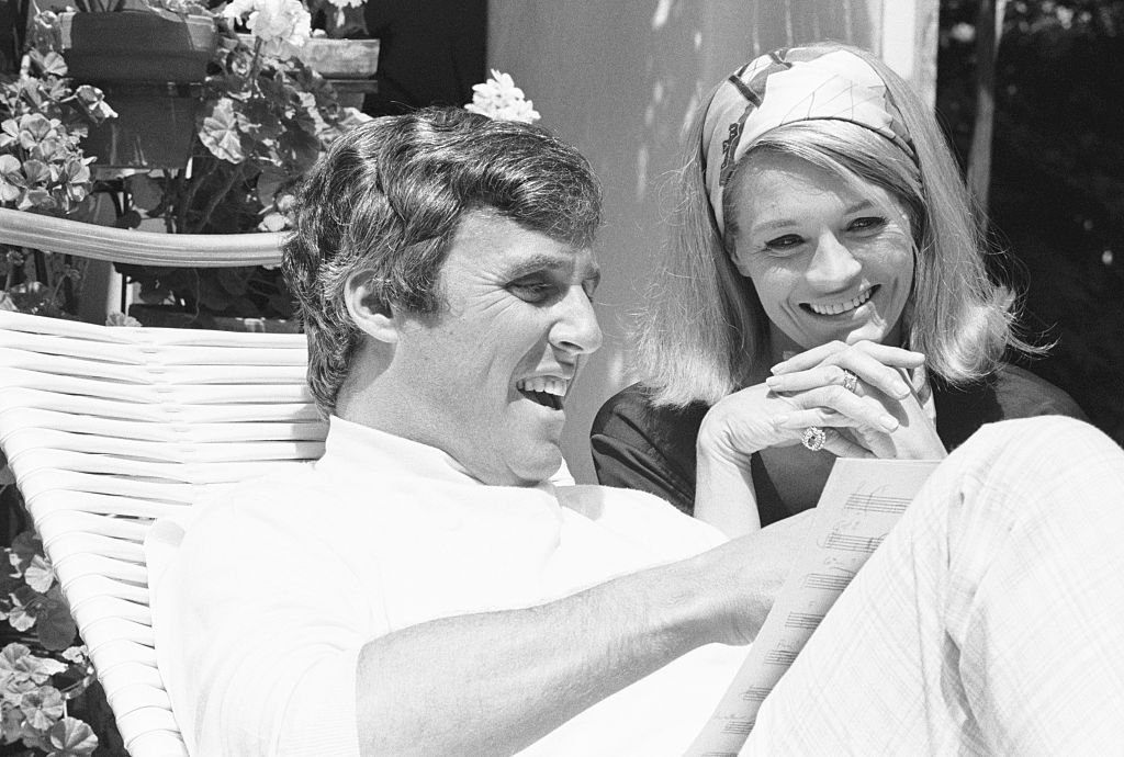 Composer Burt Bacharach and wife, actress Angie Dickinson, review some of Burt's new songs on the patio of their home. Los Angeles, California, in 1960.   Source: Getty Images