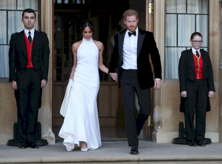 Meghan Markle and Prince Harry on their way to their wedding reception Source | Photo: Getty Images