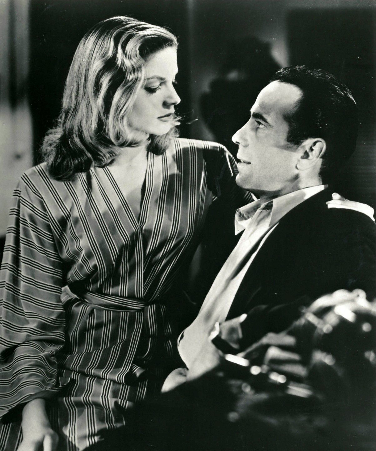 "Photo of Lauren Bacall and Humphrey Bogart in a scene from the film ""To Have and Have Not."" 