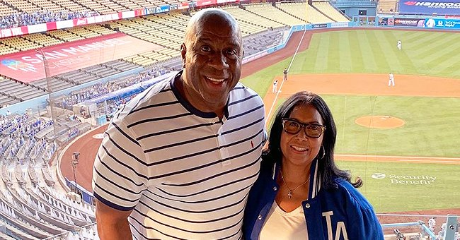 Magic & Cookie Johnson Enjoy the LA Dodgers' Opening Game against the Giants in an Empty Stadium