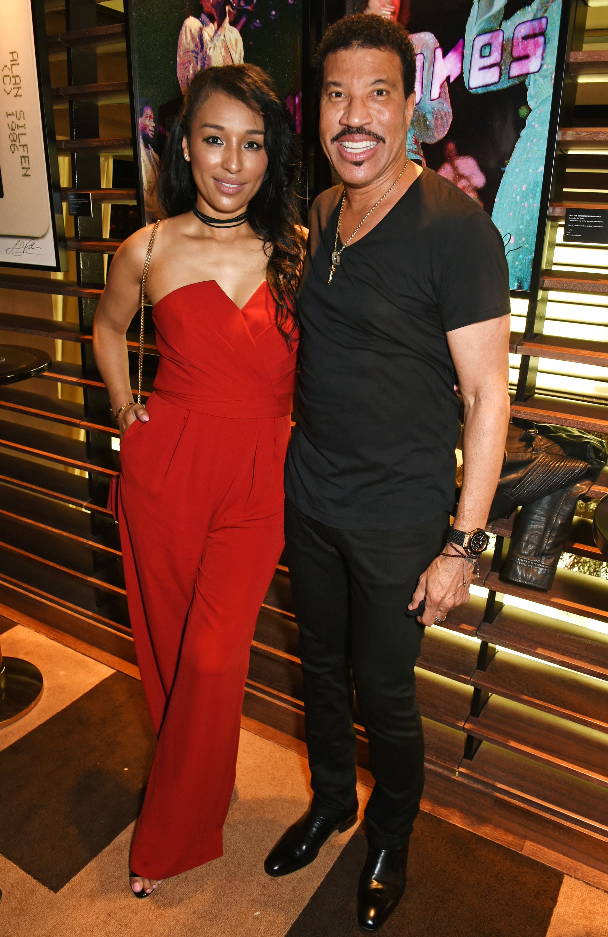 Lisa Parigi and Lionel Richie at the exclusive Lionel Richie exhibition 'STILL' on July 5, 2016 in London. | Photo: Getty Images