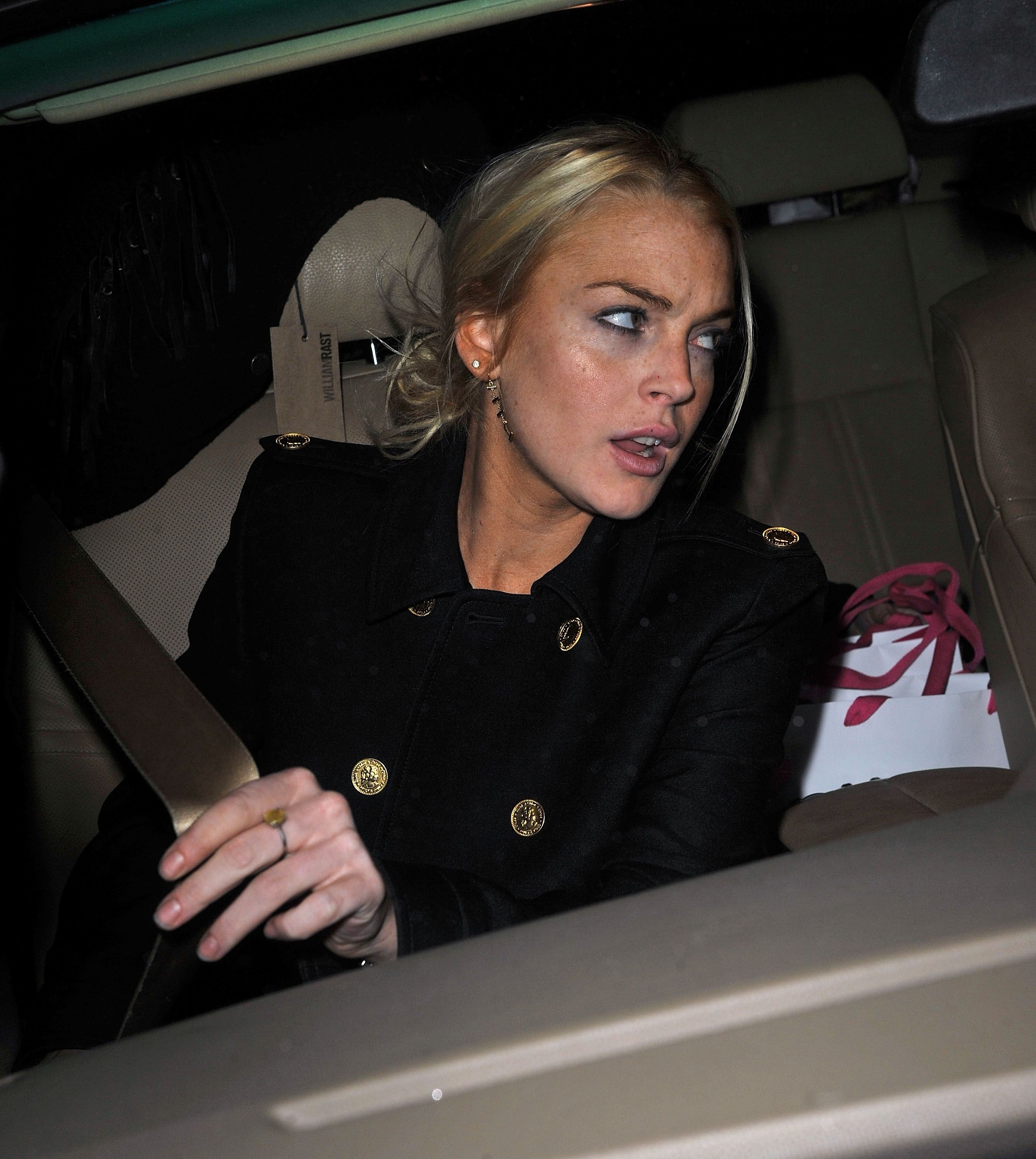 Lindsay Lohan leaving Intermix in SoHo in New York City. | Photo: James Devaney/WireImage via Getty Images