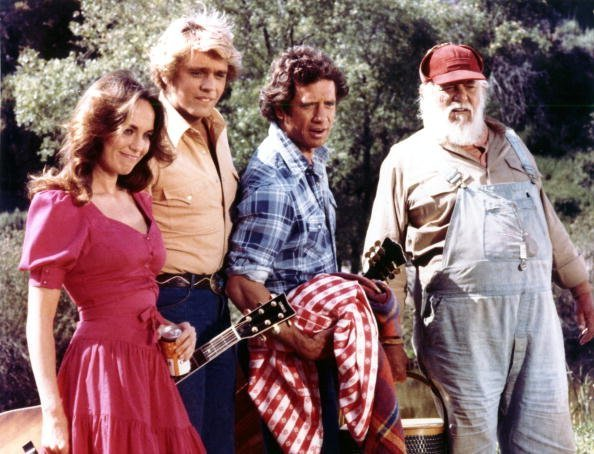 """Undated photo of John Schneider, Tom Wopat, Catherine Bach, and Denver Pyle from the action-comedy television series """"The Dukes of Hazzard,"""" which aired from 1979 to 1985. 