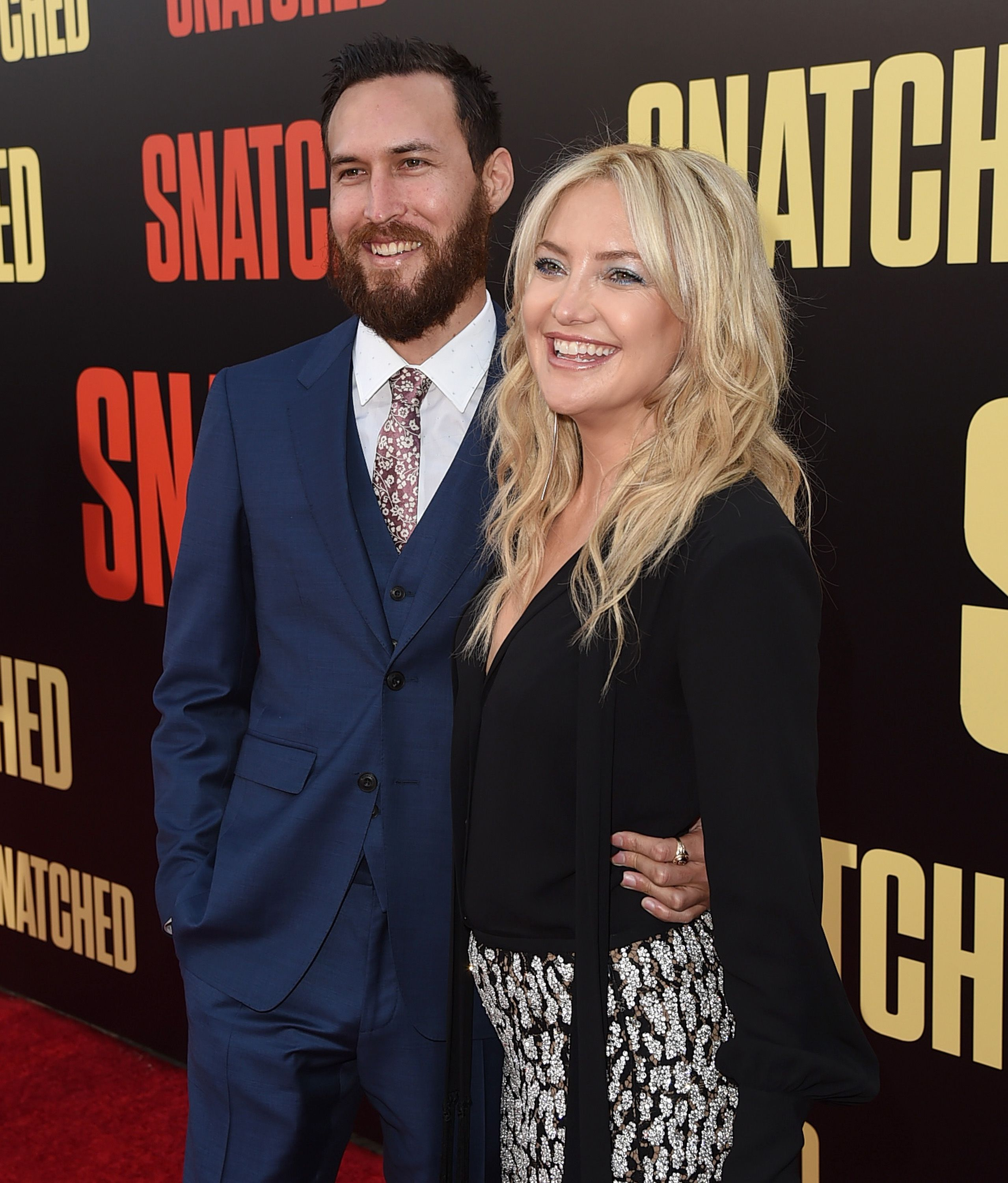 "Danny Fujikawa and actor Kate Hudson at the premiere of ""Snatched"" at Regency Village Theatre on May 10, 2017, on Westwood, California 