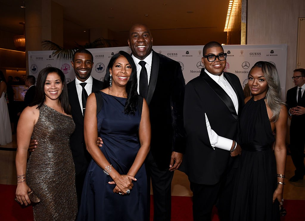 Lisa Johnson, Andre Johnson, Cookie Johnson, Earvin 'Magic' Johnson, EJ Johnson, and Elisa Johnson at the 2014  Carousel of Hope Ball at The Beverly Hilton Hotel on October 11, 2014 in Beverly Hills, California| Source: Getty Images
