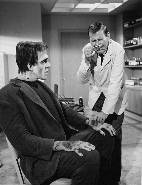 "Fred Gwynne as Herman Munster and Paul Lynde as a doctor he's consulting for weight loss from ""The Munsters."" 