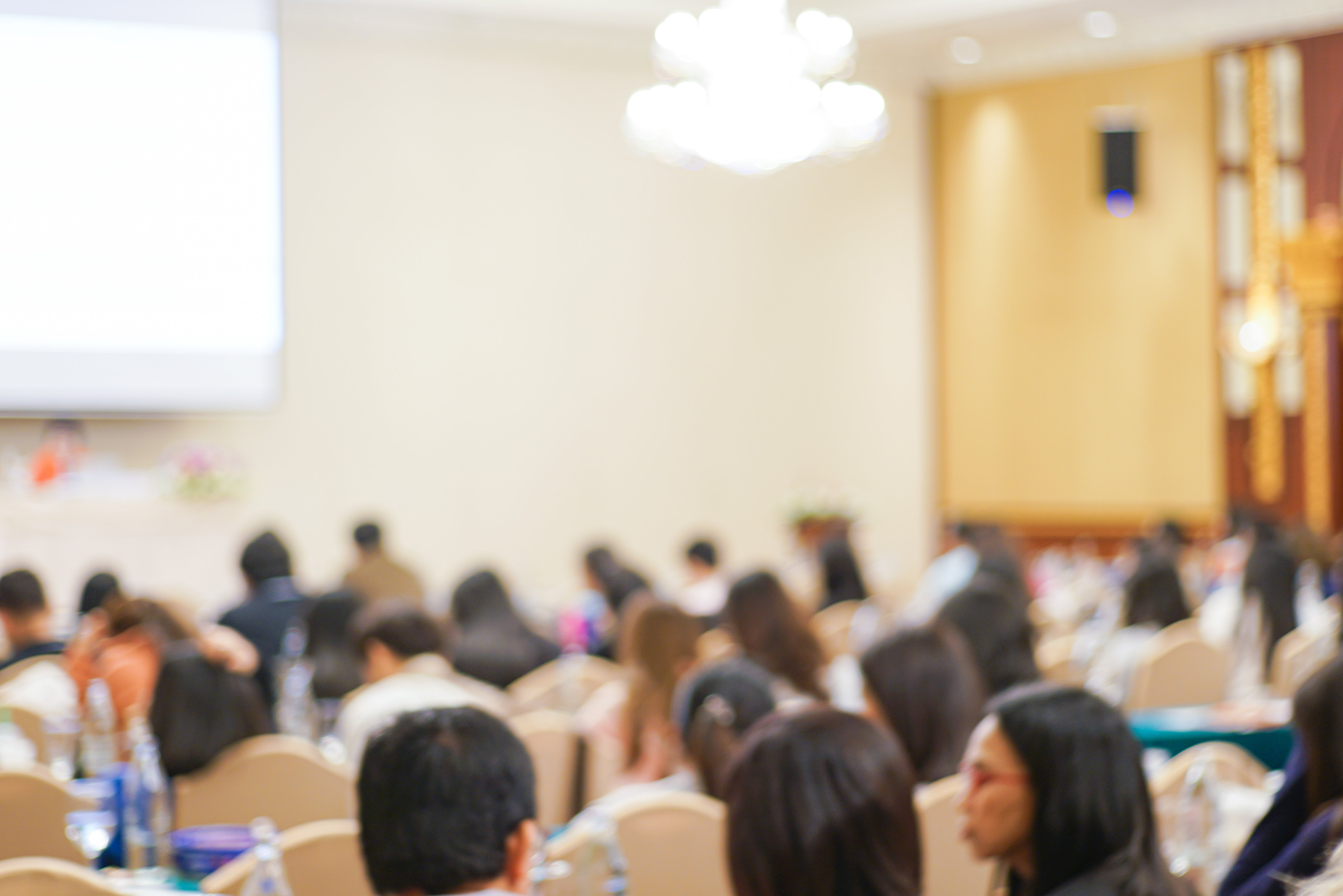 A lecture hall full of university students.│Source: Shutterstock