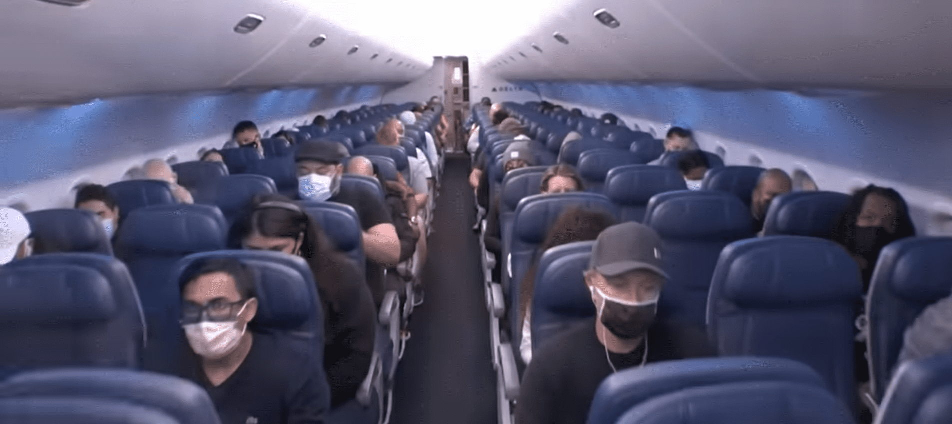 Passengers sitting on an airplane.   Source: youtube.com/Inside Edition