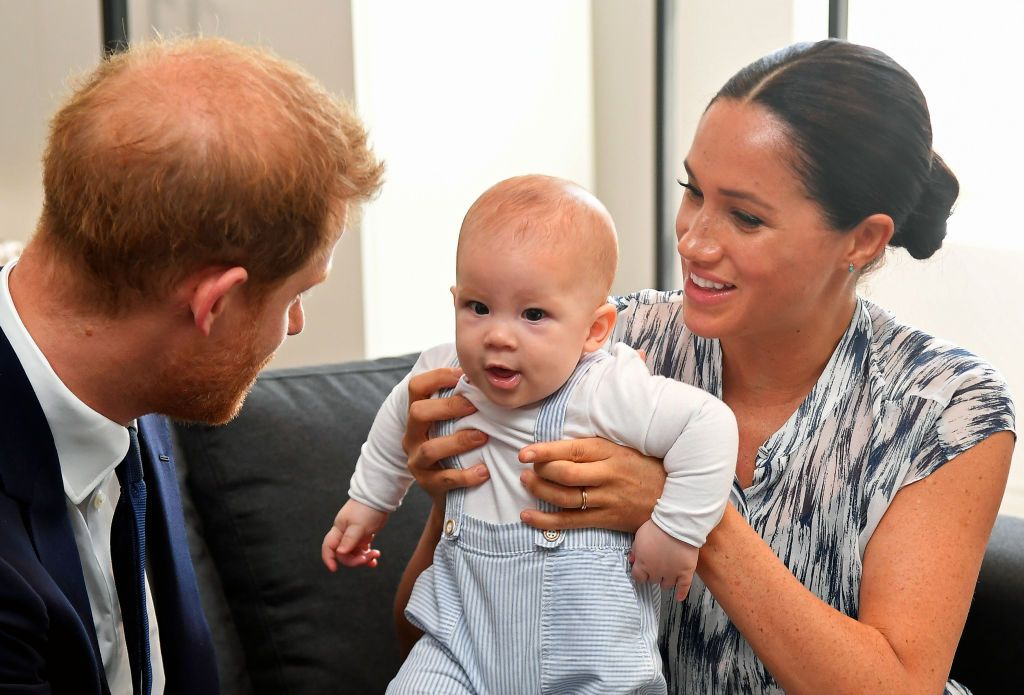 Meghan Markle and Prince Harry tend to their baby son Archie Mountbatten-Windsor at a meeting with Archbishop Desmond Tutu during their royal tour of South Africa on September 25, 2019 in Cape Town, South Africa | Photo: Getty Images