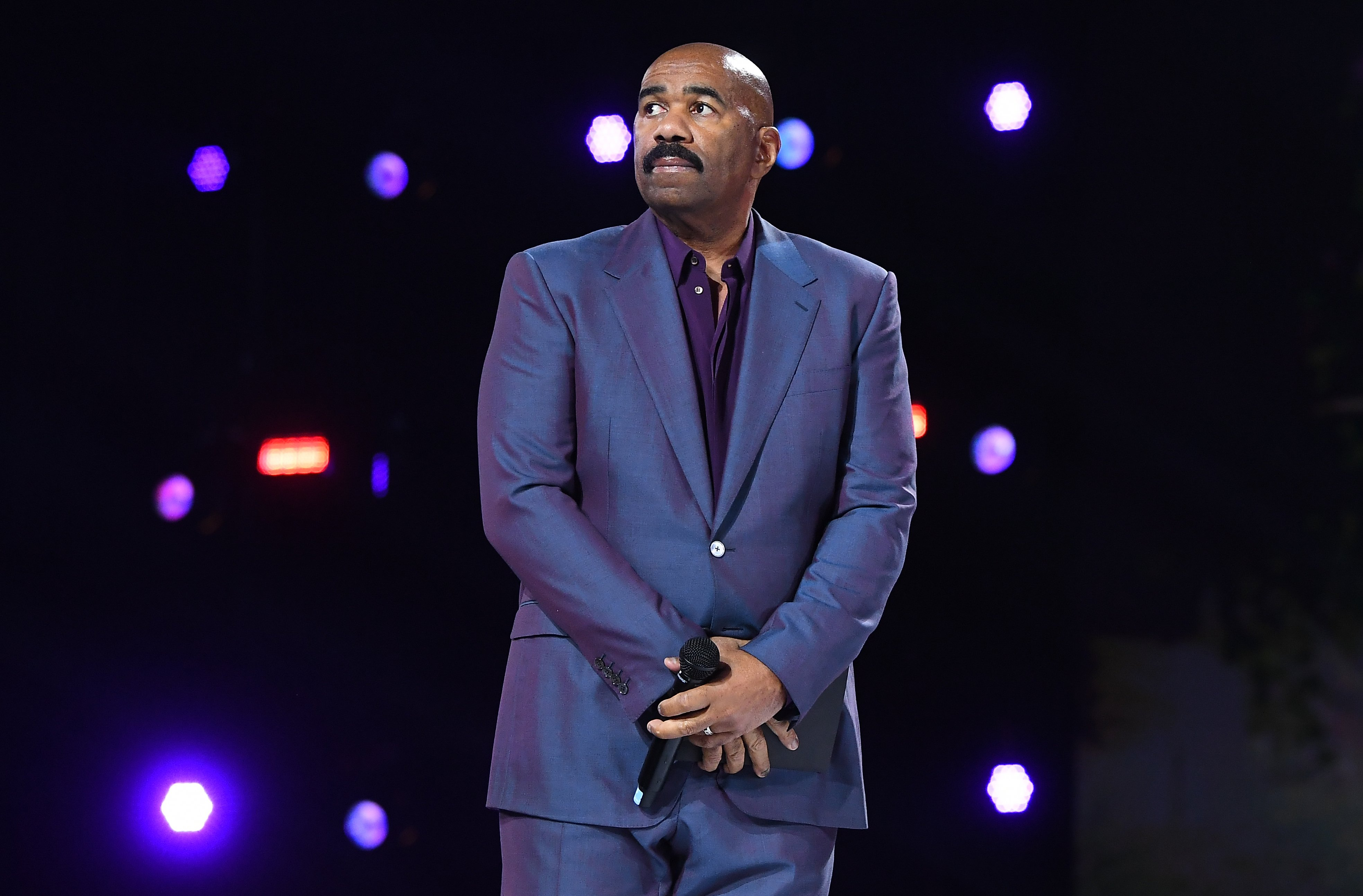 Steve Harvey onstage during the Beloved Benefit at Mercedes-Benz Stadium in Atlanta, Georgia.   Photo: Getty Images