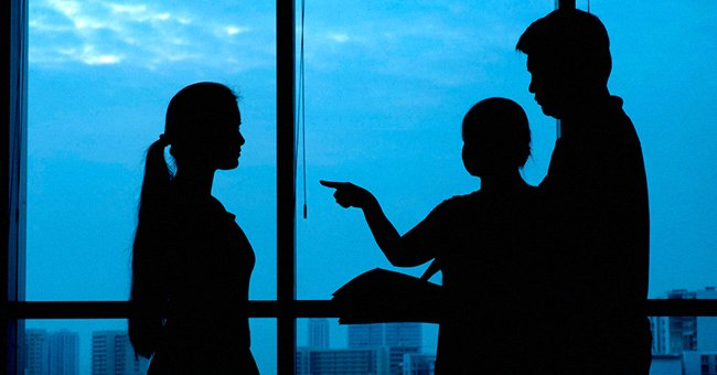 Silhouette of three people, one of them pointing a finger   Source: Shutterstock