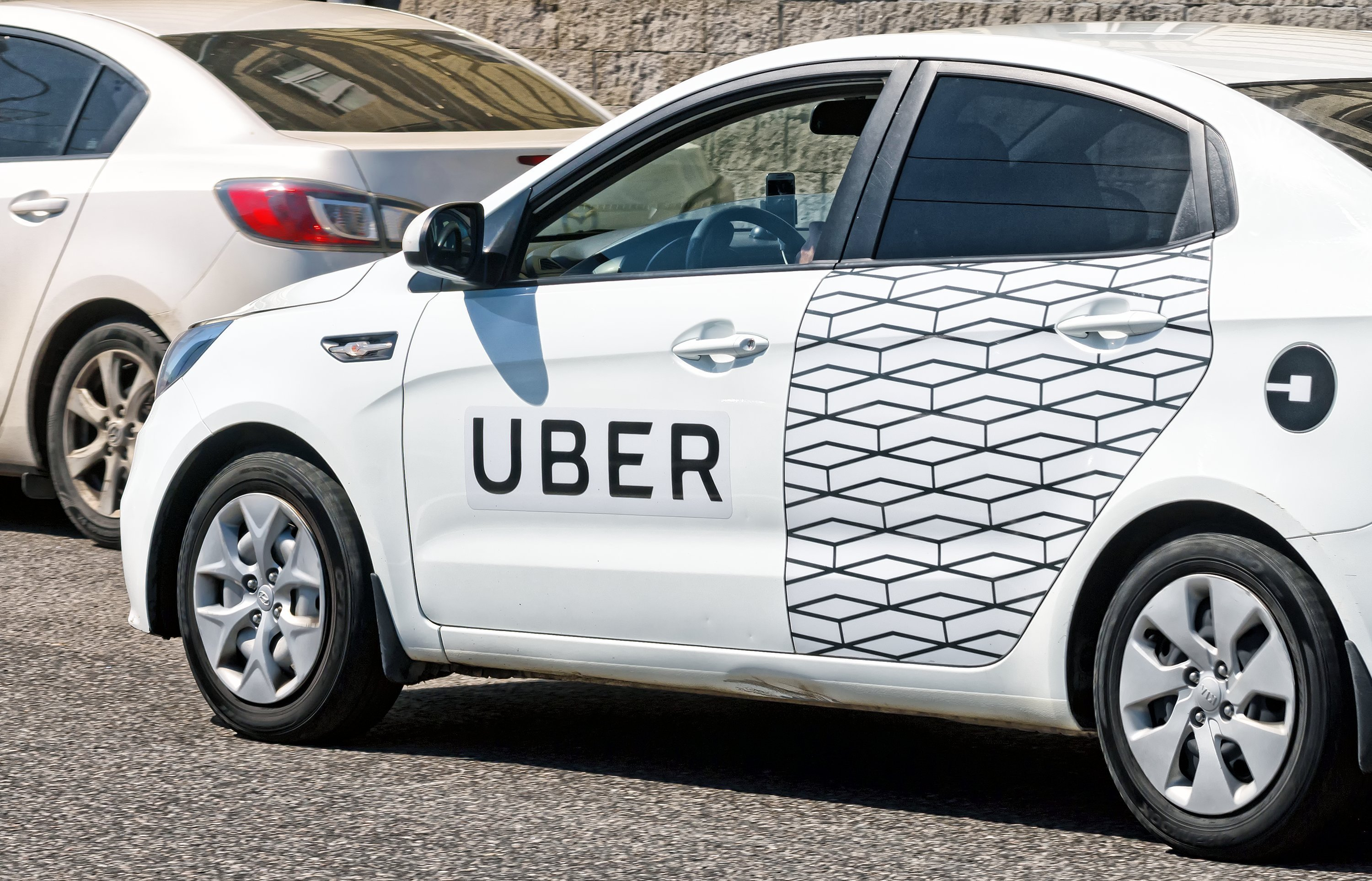 White car with Uber decals. | Source: Shutterstock