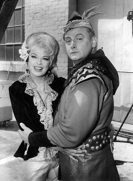 "Photo of Art Carney as the Archer and Barbara Nichols from the television program ""Batman."" 