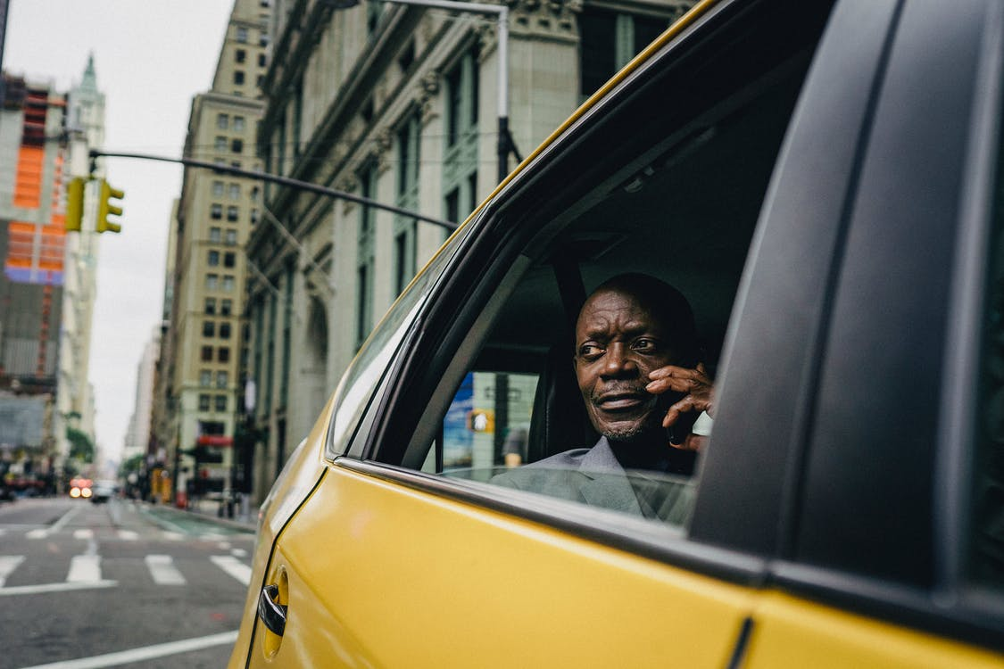 A photo of a passenger in a taxi.   Photo: Pexels