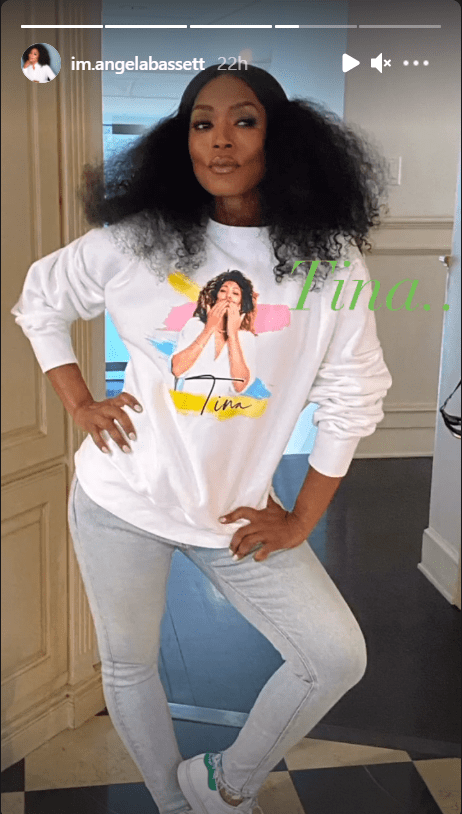 Angela Bassett's Instagram Story photo showing her wearing a white sweater printed with Tina Turner's image.   Photo: instagram.com/im.angelabassett