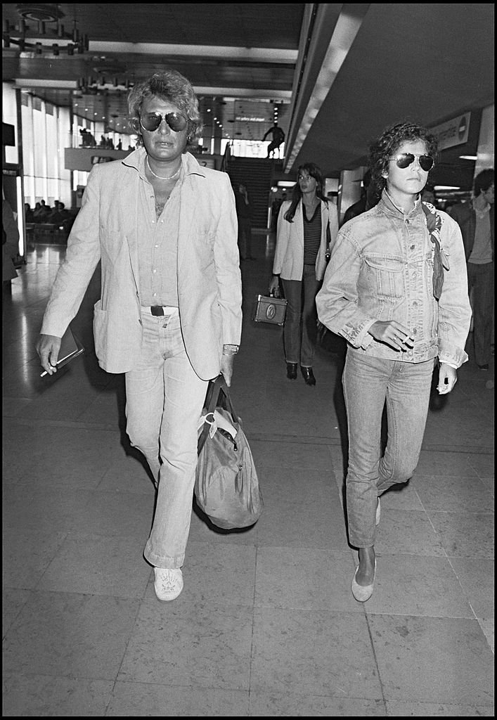Johnny Hallyday et Babeth Etienne | Source : Getty Images