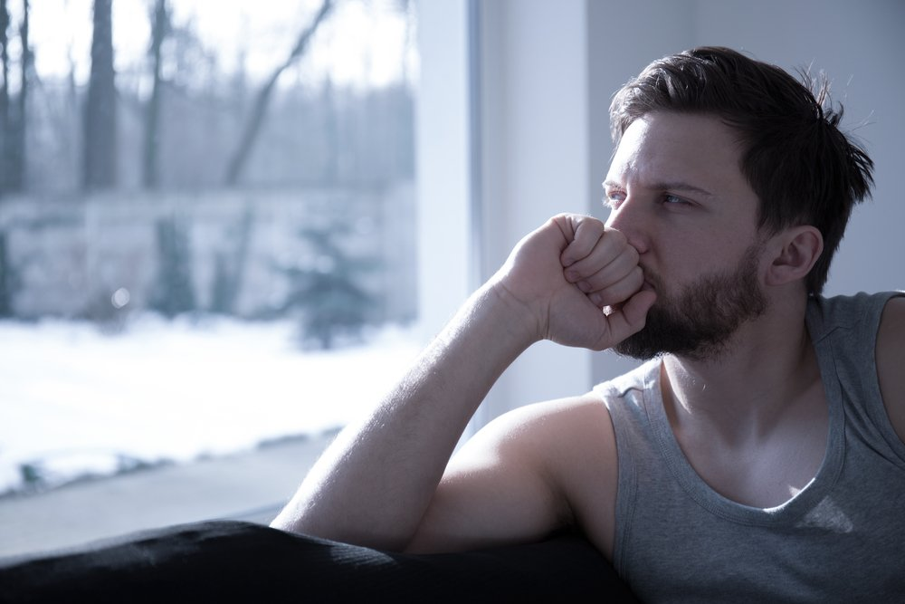 A portrait of a concerned man staring outside. | Photo: Shutterstock