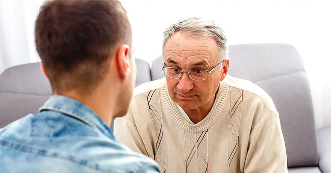 A man and his son having a discussion. | Photo: Shutterstock