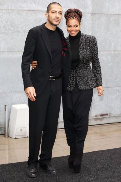 Wissam al Mana and Janet Jackson attend the Giorgio Armani fashion show during Milan Fashion Week. | Source: Getty Images