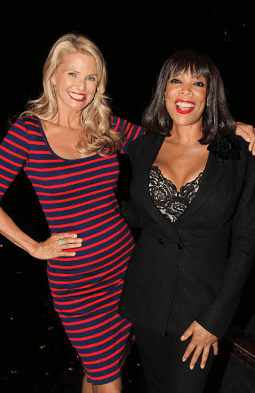 """Christie Brinkley and Wendy Williams embrace backstage at the musical """"Chicago"""" at The Ambassador Theater, on July 9, 2013, New York 