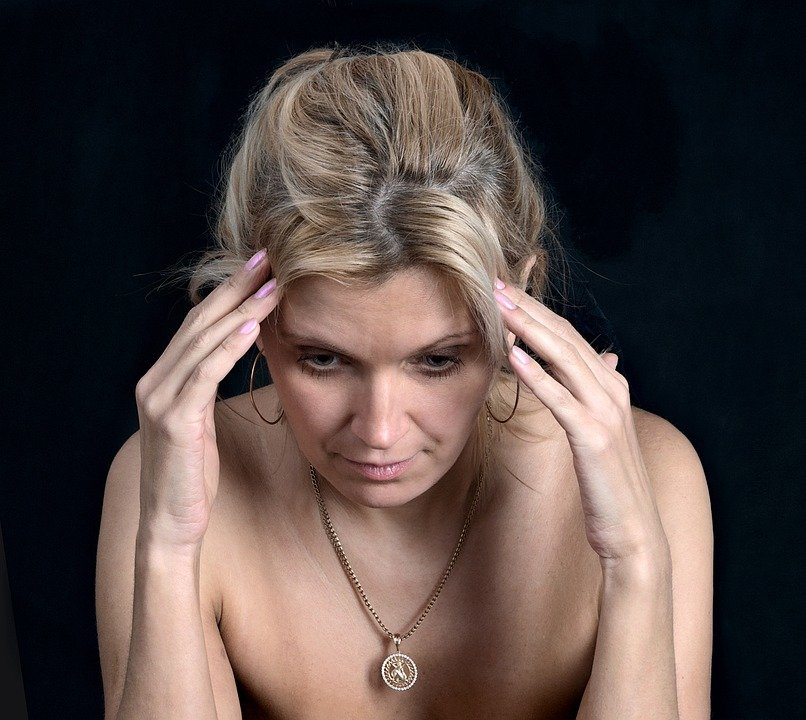 A photo of a worried woman with her hand's on her head.   Photo: Pixabay