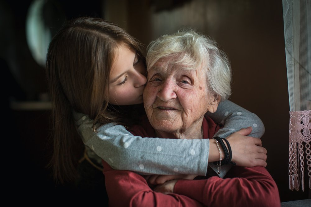 Hugs and kisses from a granddaughter to her grandma | Photo: Shutterstock