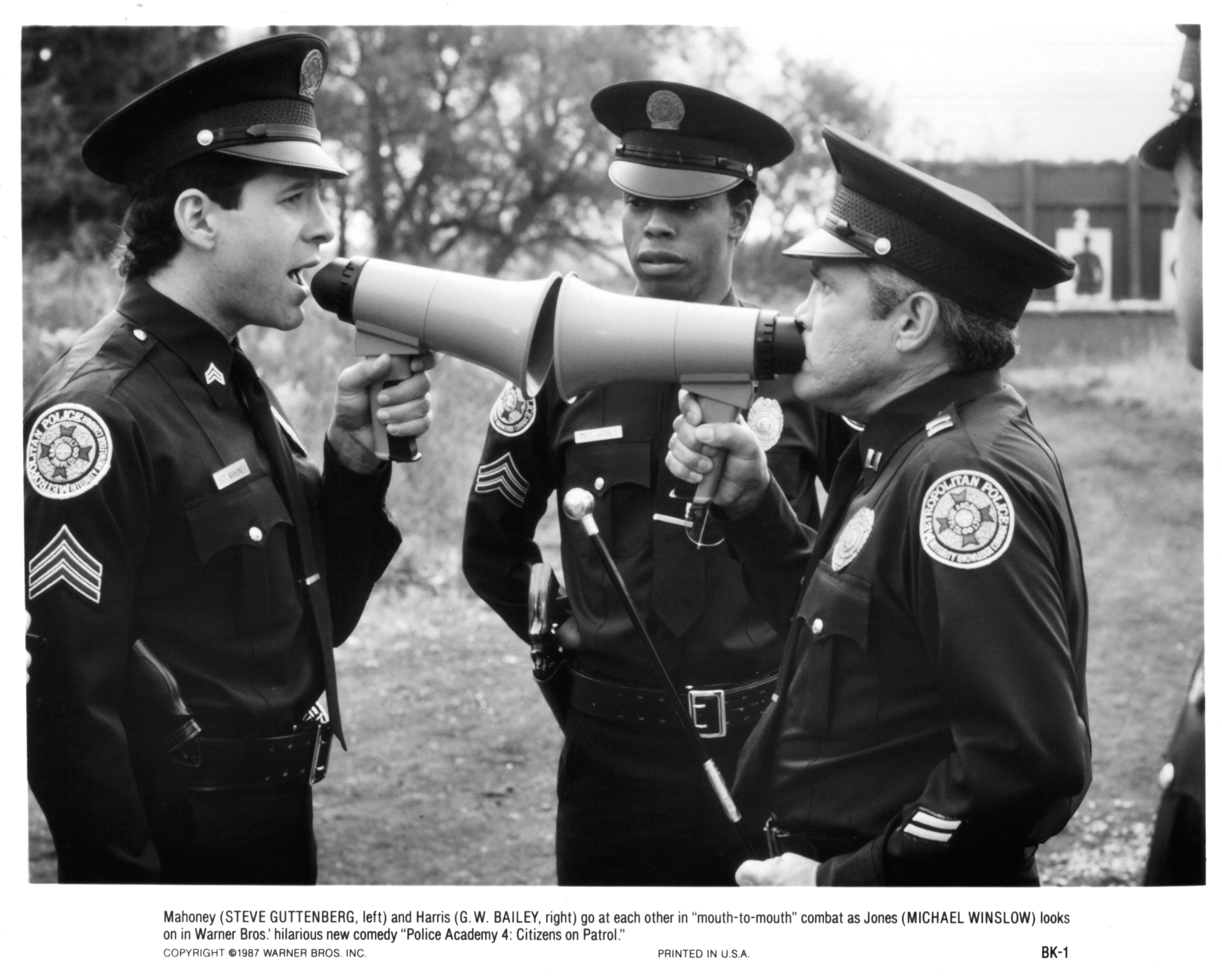 """Actor Michael Winslow with Steve Guttenberg and G.W. Bailey on the set of the movie """"Police Academy 4: Citizens on Patrol"""" in 1987   Photo: Getty Images"""