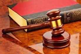Gavel and a law book  | Photo: Shutterstock