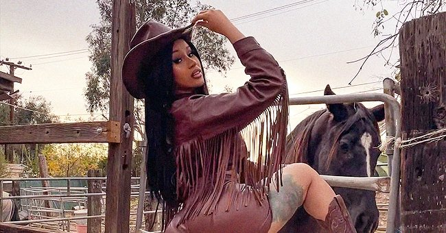 Check Out Cardi B Showing off Her Colorful Leg Tattoos Posing in a Tight Leather Cowboy Outfit