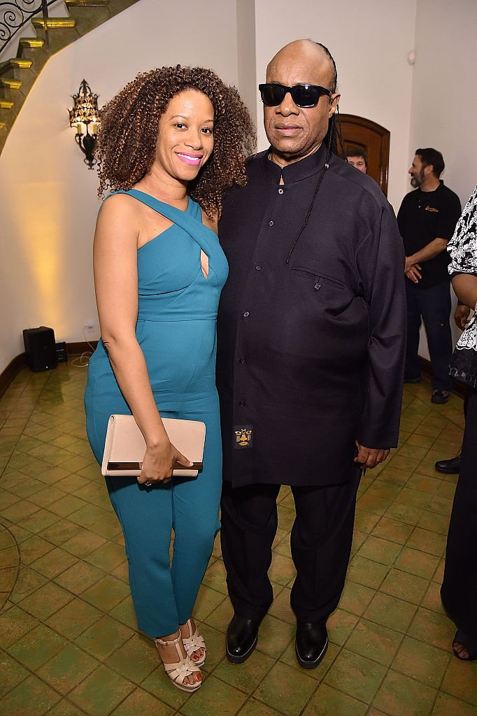 Stevie Wonder (R) and Tomeeka Robyn Bracy attend The Dinner For Equality co-hosted by Patricia Arquette and Marc Benioff  | Getty Images / Global Images Ukraine