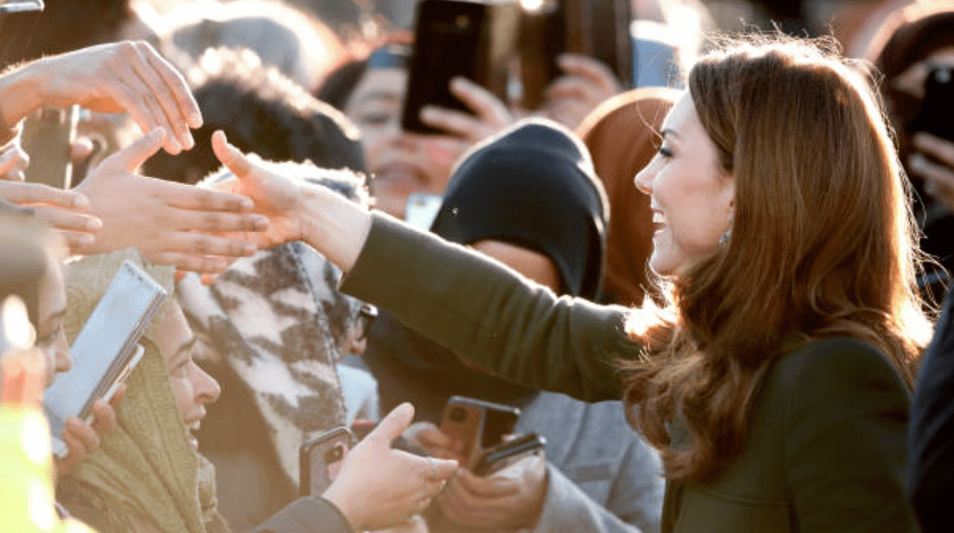 During her first engagement of the year, Kate Middleton shakes hands with crowds during a visit at the Khidmat Centre, on January 15, 2020, in Bradford, England | Source: Max Mumby/Indigo/Getty Images
