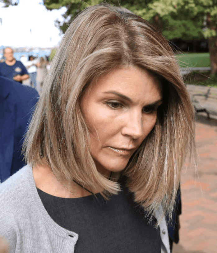After her court appearance for the college admission scandal, Lori Loughlin leaves looks disheartened as she leaves the John Joseph Moakley United States Courthouse, August. 27, 2019, Boston | Source: Pat Greenhouse/The Boston Globe via Getty Images