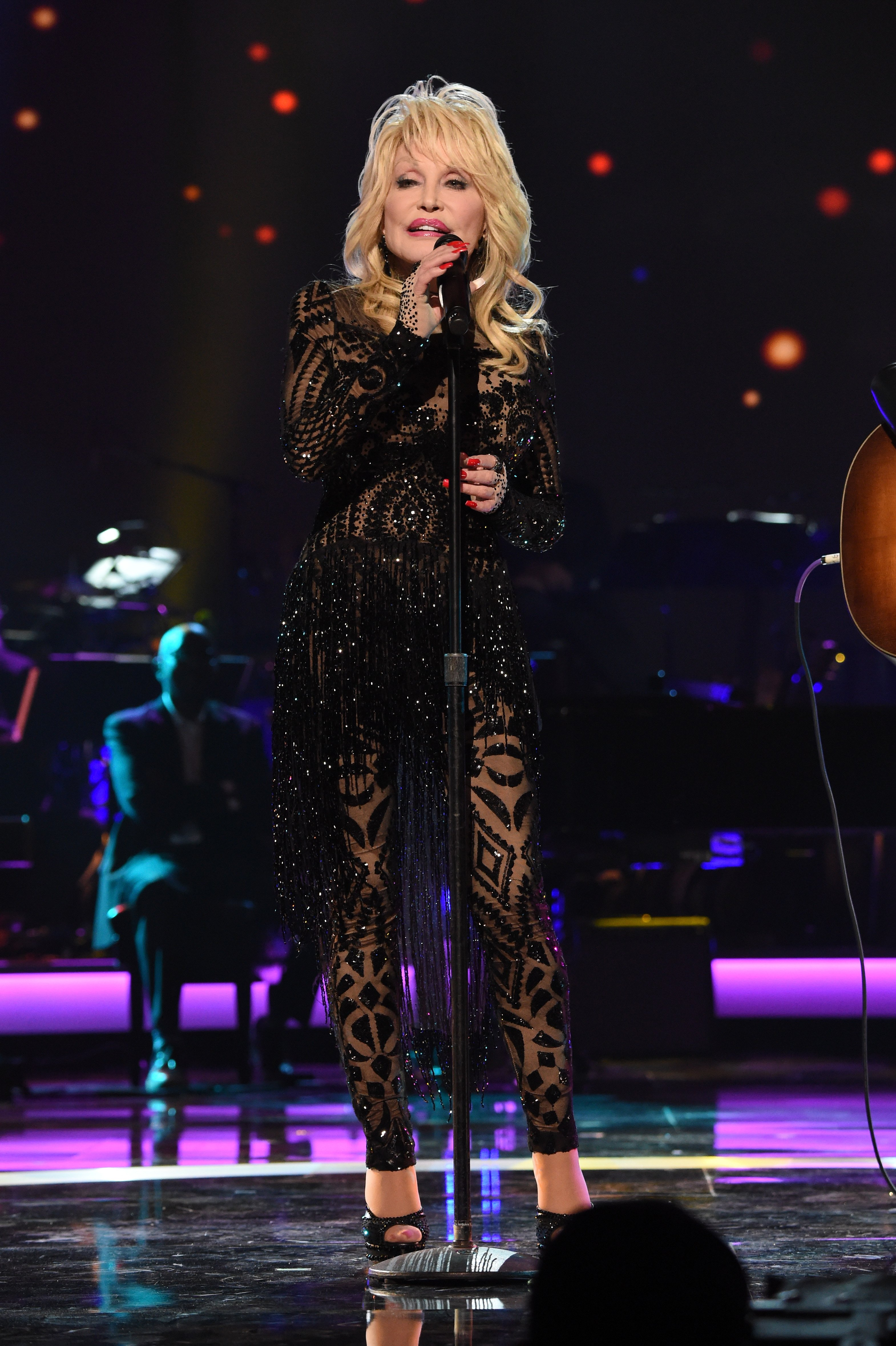 Dolly Parton performs onstage MusiCares Person of the Year at Los Angeles Convention Center on February 8, 2019. | Photo: GettyImages