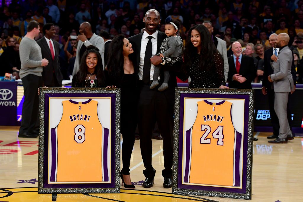 """The Bryant family celebrating the retirement of LA Lakers jersey numbers """"8"""" and """"24"""" to celebrate Kobe's 20-year career 