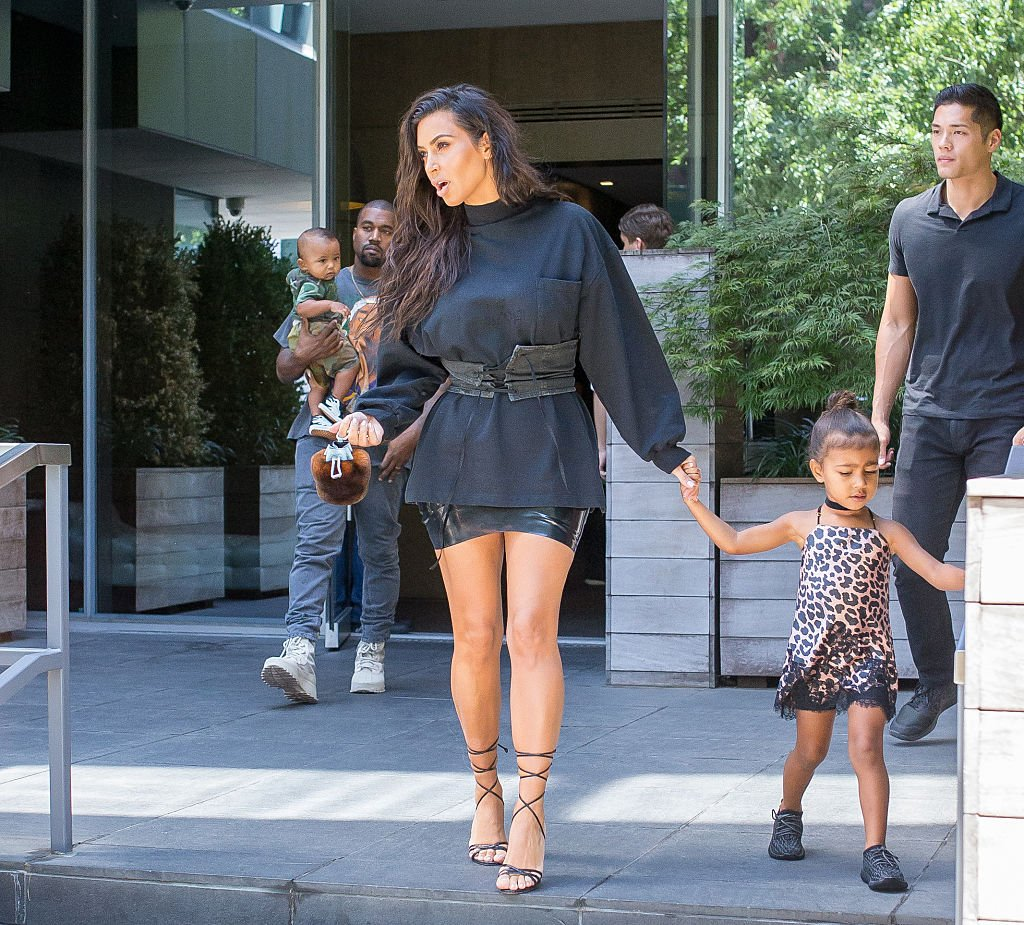 Kim Kardashian and Kanye West with children are seen leaving their hotel on August 29, 2016. | Photo: Getty Images
