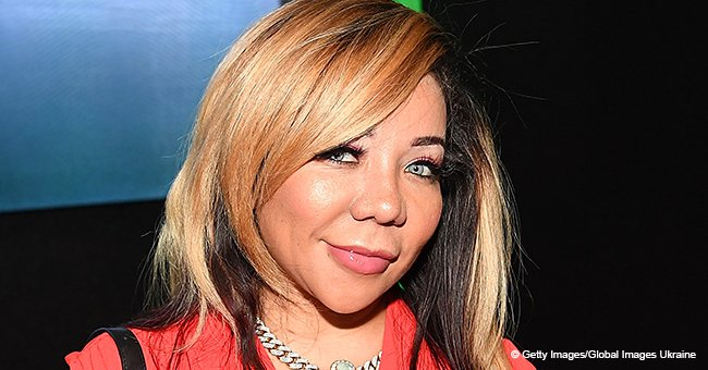 Tiny Harris & Daughter Heiress Rock Matching Outfits and Sunglasses While Posing on Expensive Cars