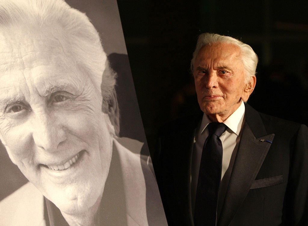 "Kirk Douglas poses next a portrait of himself as he arrived at the SBIFF's 3rd Annual ""Kirk Douglas Award For Excellence in Film,"" at the Biltmore Four Seasons Hotel, on October 2, 2008, in Santa Barbara, California 
