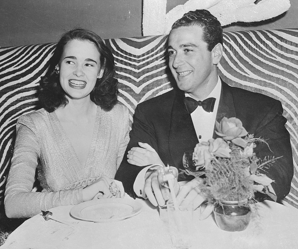 Gloria Vanderbilt at a local nightclub with Pasquale (Pat) DiCicco. | Source: Getty Images