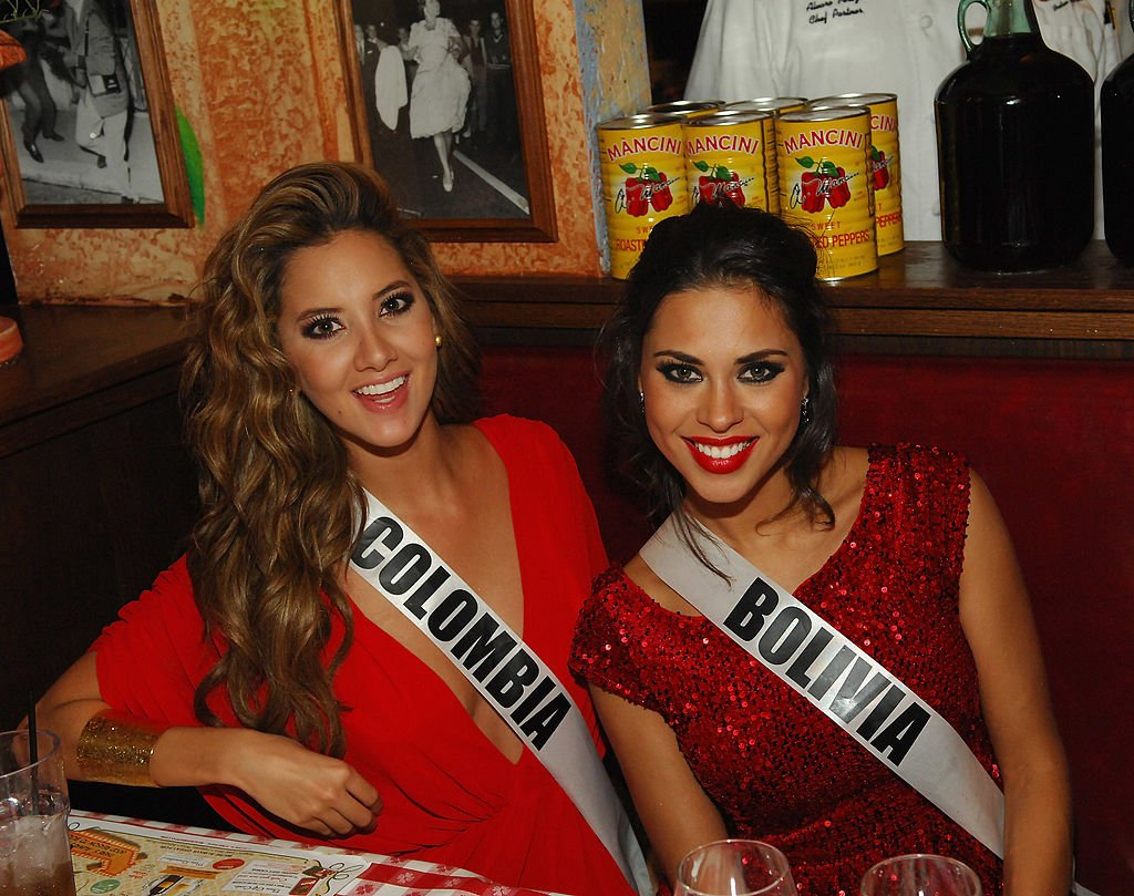 Miss Columbia Daniella Margarita Alvarez Vasquez and Miss Boliva Yessica Mouton appear at the Buca di Beppo Italian Restaurant on December 6, 2012. | Photo: Getty Images