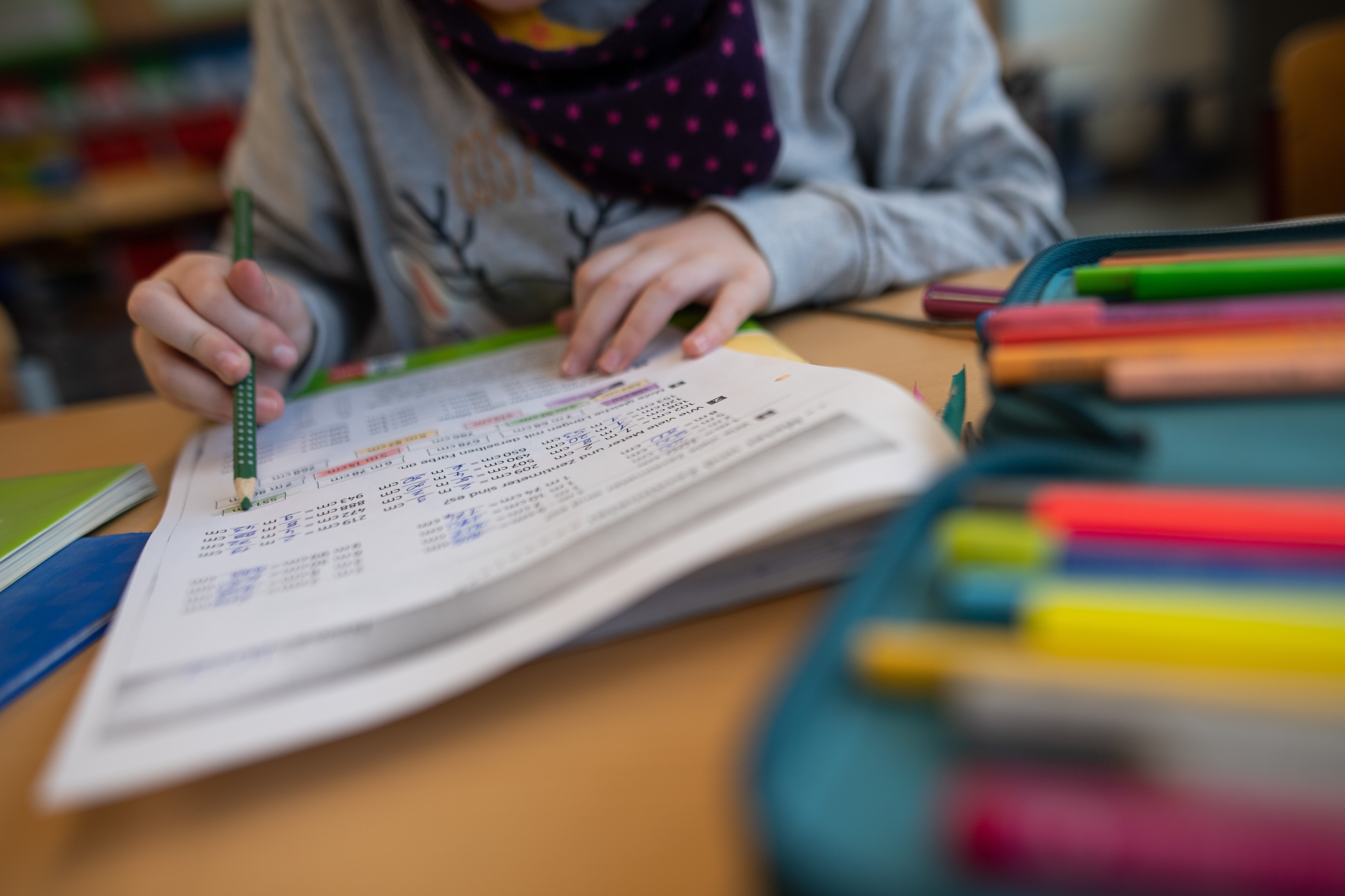 A girl solves a math problem in a primary school|Photo: Getty Images