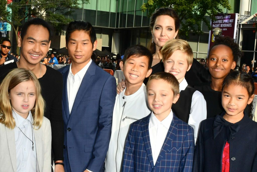 Angelina Jolie with her children Vivienne, Maddox, Pax, Knox, Shiloh, Zahara, and actors Kimhak Mun and Sareum Srey Moch at the Toronto International Film Festival in 2017 | Source: Getty Images
