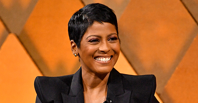 See Tamron Hall's Baby Moses Beam While in Fashion Icon André Leon Talley's Arms