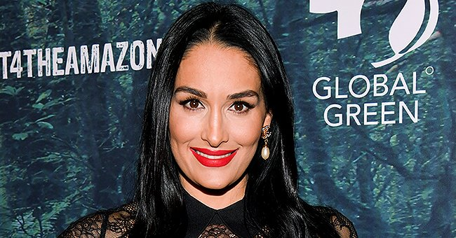 Pregnant Nikki Bella Looks Gorgeous in Red Silk Dress in a Recent Photo