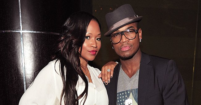 Ne-Yo's Ex-wife Monyetta Shows off Her Curves in White Dress with a Slit & Thigh-High Boots