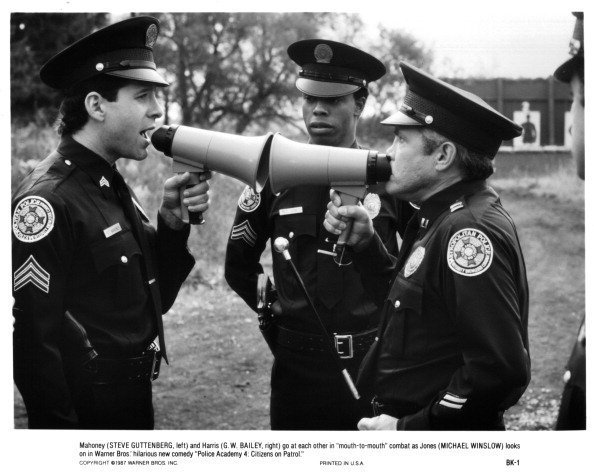 "Steve Guttenberg, Michael Winslow and G.W. Bailey on set of the movie ""Police Academy"" circa 1987 