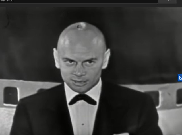 """Yul Brynner wins the Oscar for Best Actor for """"The King and I"""" at the 29th Academy Awards at the 1957 Oscars 