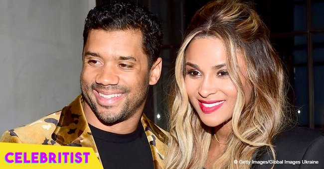 Ciara stuns in black maxi dress with slit, posing next to husband in recent photo