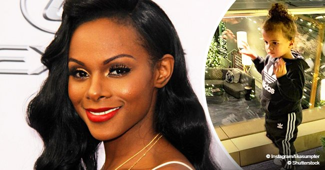 Tika Sumpter shares photo of daughter in curly updo, chilling with 'bestie' by Christmas tree