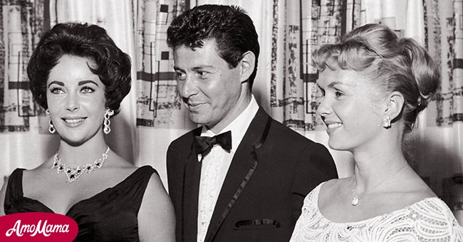 Elizabeth Taylor with Eddie Fisher and Debbie Reynolds at an event   Photo: Getty Images