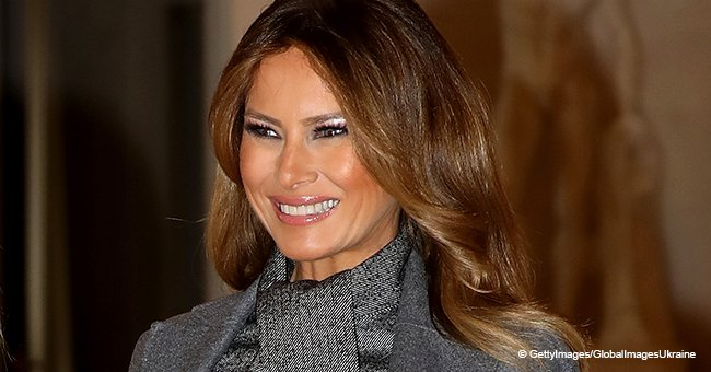 Melania Trump looks chic in a grey dress with a pleated skirt leading the First Wives in Paris